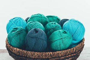 blue and green knitting wool balls i