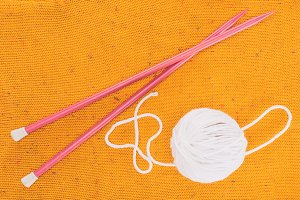 top view of white yarn ball and knit