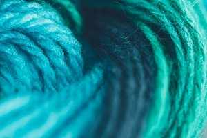 close up view of blue and green knit