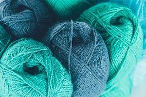 close up of blue and green knitting