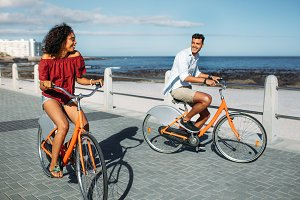 Couple riding bicycles in street