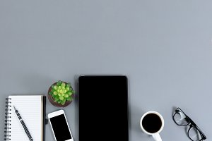 Flat gray desk with light tech