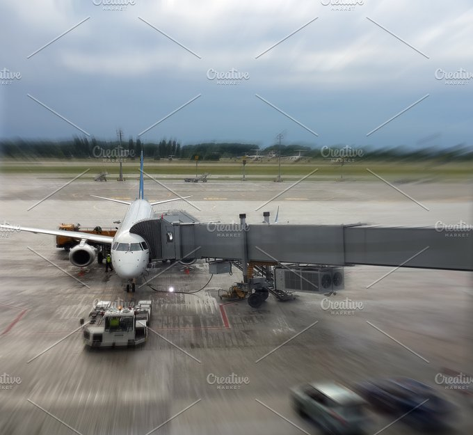 Airplane in airport. Blur motion. - Transportation