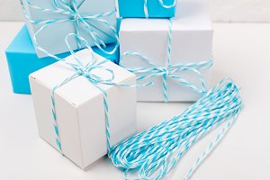 blue and white gift boxes with ribbo