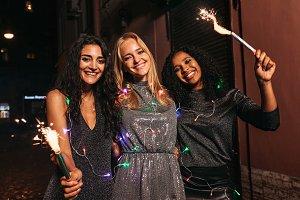 Three women celebrating new year
