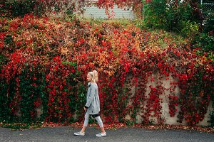 Girl Walking in City Fall Leaves