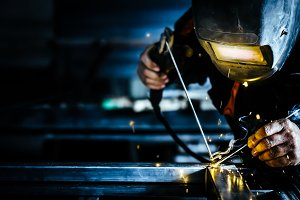 Metal welding and sparks metal.