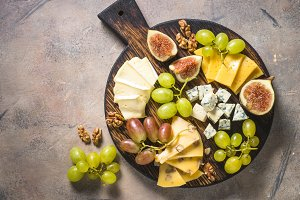 Cheese plate with grapes, figs and