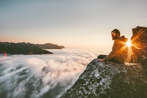 Man relaxing alone on the edge cliff