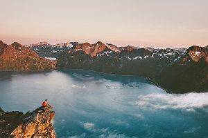 Man sitting on the edge cliff