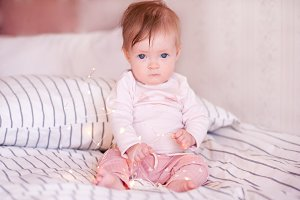 Cute baby girl in bed