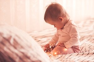 Baby in bed with lights