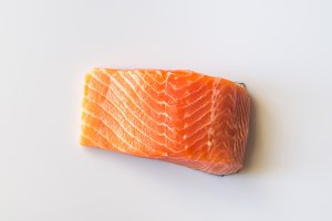 Raw salmon on the white background