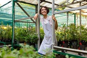 Gardener standing over flowers plant