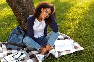African young woman sitting outdoors