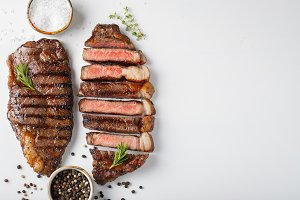 Two grilled marbled beef steaks stri