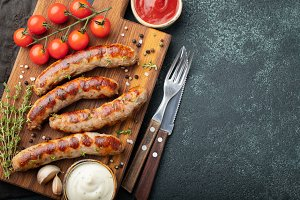 Fried sausages with sauces and herbs