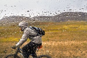 Mountain bike rider in rain