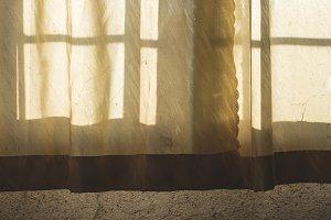 An old curtain on a window