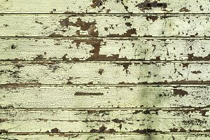 Wooden background with cracked paint