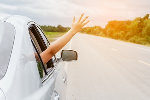 Woman hand in the car relaxing
