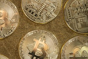 Bitcoin coins on gold color
