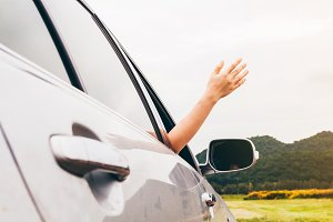 Woman hand on the car relaxing