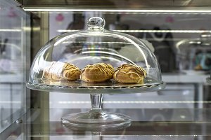 Eclair on showcase in the pastry sho