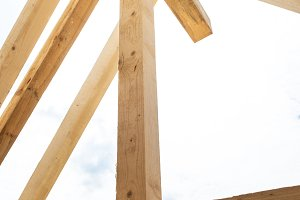 Building a house, wooden beams