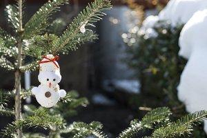 Snowman on fir