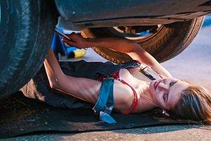 Sexy mechanic girl lying under the