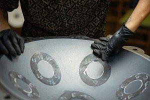 Craftsman designing handpan instrume