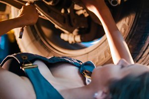 Sexy mechanic girl lays under the