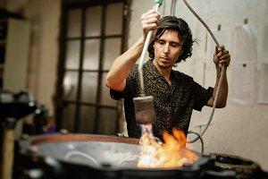 Artisan constructing handpan
