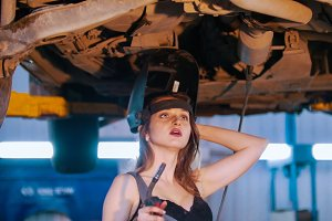 Mechanic girl in a opened helmet