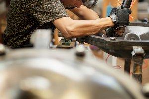 Artisan constructing handpan with ha