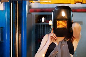 Sexy mechanic girl with a helmet on