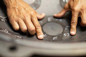 Hands designing handpan