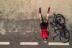 cyclist lying on the road