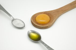 Egg yolk on wooden spoon