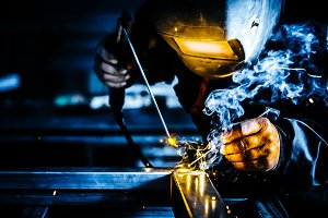 Welder man working on metal