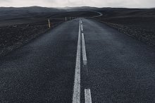 Black road in Iceland by  in Transportation