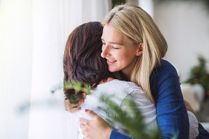 Senior woman with adult daughter at