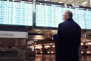 Man near airline schedule