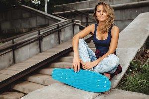 girl posing with skate board