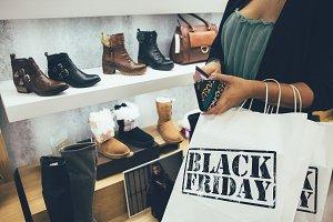 Female shopper pays on black friday