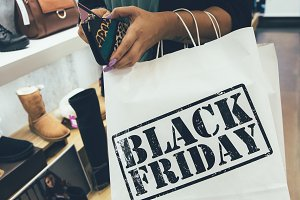 Female shopper paying on black frida