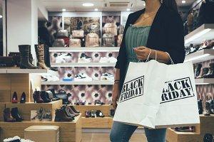 Female shopper holding shopping bags