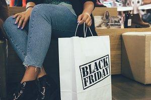 Female shopper holding shopping bag