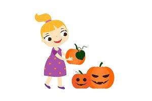 girl holding halloween pumpkins